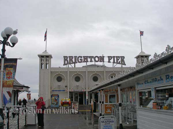 Walking along Brighton Pier