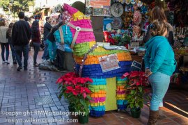 this burro pinato is asking for donations to keep the traditions of Olvera Street going